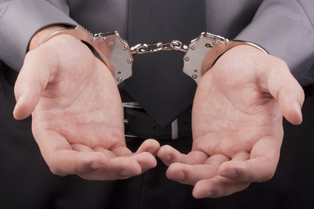 Arrest, close-up shot man's hands with handcuffs. Stock Photo - 9201646