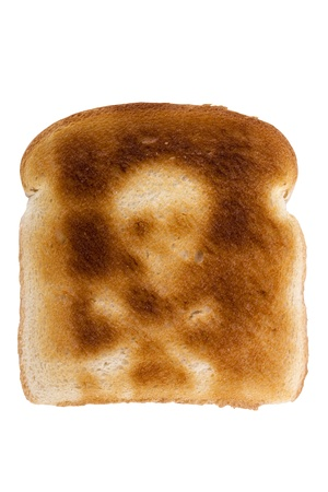 radiated: A toasted slice of white bread with a skull and bones symbol isolated on a white background. Stock Photo