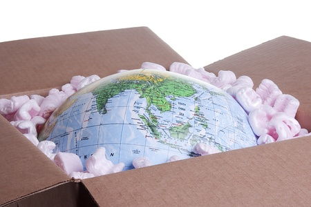 global problem: Close-up of a globe in a delivery box.