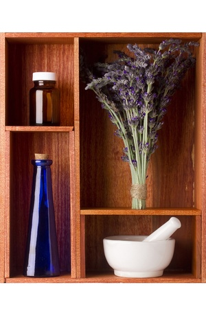 Alternative medicine equipment and lavender in a brown shelf.  photo