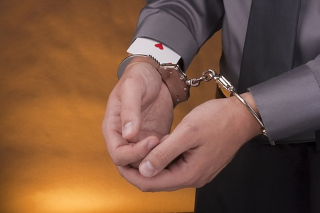 arrestment: Arrest card sharper, her hands handcuffed and from under sleeves visible ace.
