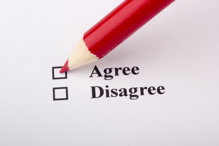 opinion: A red pencil laying on an opinion poll. Stock Photo