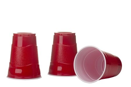 plastic cup: Red cups isolated on a white background.