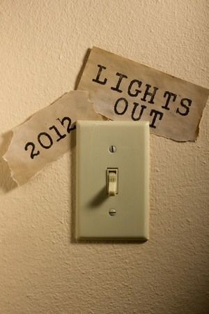 Old papers next to a light switch that say 2012 and Lights Out representing the end of the world. photo