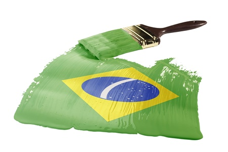 Concept of paint strokes with the colors of the flag of Brazil.