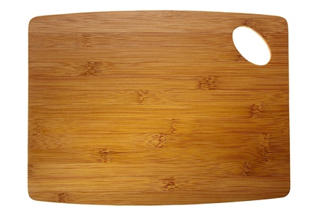 Directly above photograph of a brown cutting board isolated on a white background.