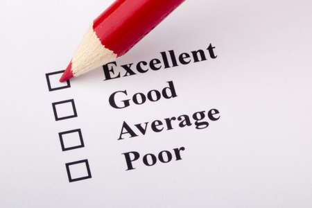 A red pencil laying on a customer service survey. Stock Photo - 9356025