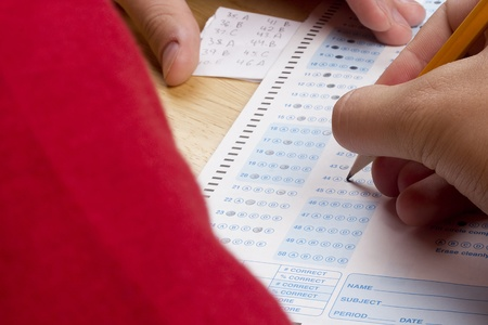 plagiarism: Student using a cheat sheet to cheat on his test. Stock Photo