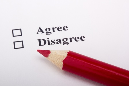 A red pencil laying on an opinion poll. Stock Photo - 9384335