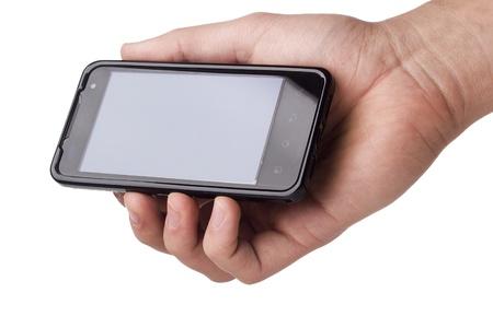 Nouveau t�l�phone G2x T-Mobile dans une main isol� sur un fond blanc. Banque d'images