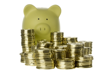Green piggy bank standing behind stacks of coins isolated on white. Stock Photo - 9523381