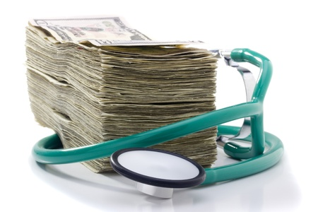 doctor money: Stack of money and a stethoscope on a white background. Stock Photo