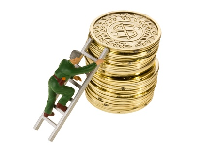 Toy man climbing a stack of golden coins on a white background. Stock Photo - 9630196