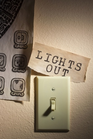 Old papers with the Mayan calendar and the words Lights Out representing the end of the world. photo