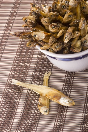 Small dry fish used in Asian cuisine. photo