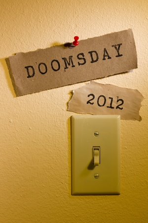 doomsday: Old papers with the words Doomsday and 2012 next to a light switch representing the end of the world. Stock Photo
