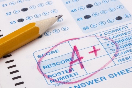 grades: Close-up photograph of a perfect grade on a scantron test.