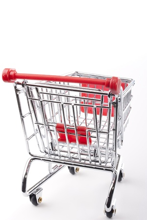 Empty shopping cart with the red handle on a white background. Stock Photo - 9760032