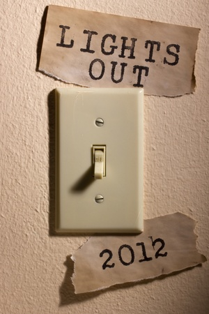 Old papers next to a light switch that say 2012 and Lights Out representing the end of the world. Stock Photo - 9755246