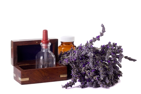 Alternative medicine equipment and lavender on a white background. photo