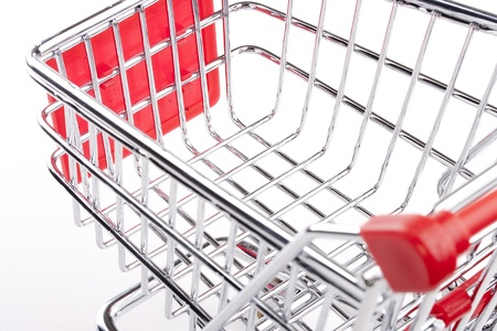 Empty shopping cart with the red handle on a white background. Stock Photo - 9848741