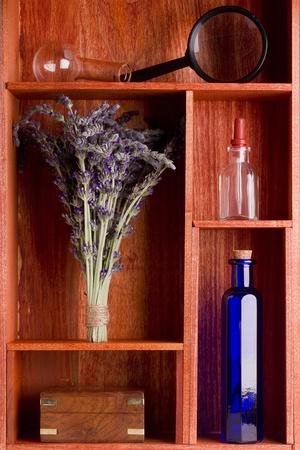 Alternative medicine equipment and lavender in a brown shelf. photo