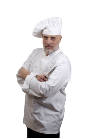 Portrait of a chef with crossed arms and a knife in a chef's hat and uniform isolated on a white background. Stock Photo - 10091896
