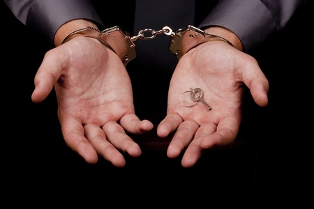 apprehension: Arrested in handcuffs in his hands the key to the handcuffs.