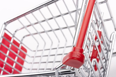 Empty shopping cart with the red handle on a white background. Stock Photo - 10138898