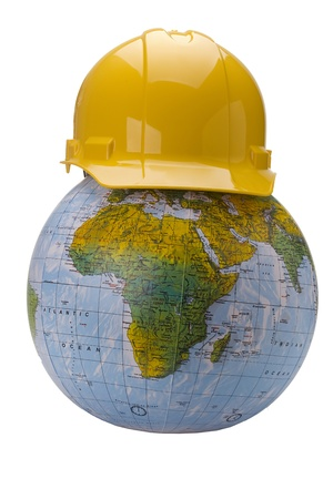 Yellow hard hat on a globe isolated on a white background. Stock fotó