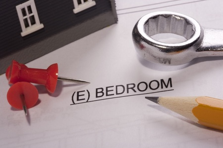 Construction tools laying on a bedroom construction plan. Stock Photo - 10293833