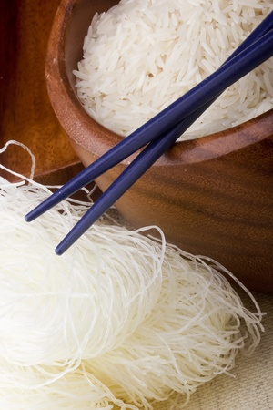 Close-up of white rice noodles and Asian chopsticks.
