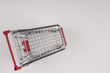 Empty shopping cart with the red handle on a white background. Stock Photo - 10332772