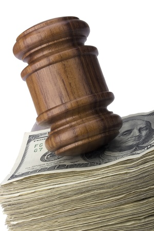 Law gavel on a stack of American money. photo