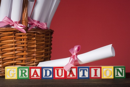 Diploma tied with a ribbon, the text of the wooden blocks  photo
