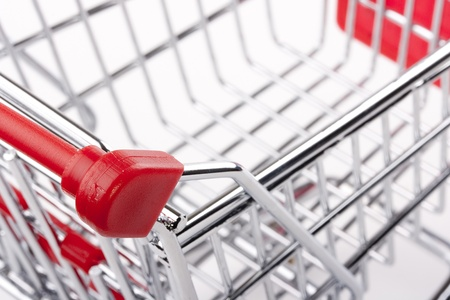 Empty shopping cart with the red handle on a white background. Stock Photo - 10506896