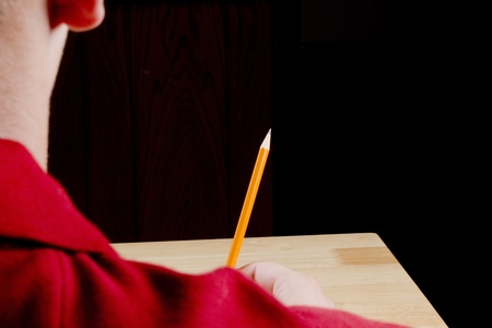Student sitting at a desk waiting for his test. Add your text to the background. Stock Photo - 10506897