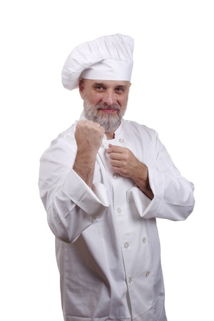 Portrait of a chef in a fighting stance in a chef's hat and uniform isolated on a white background. Stock Photo - 10597656