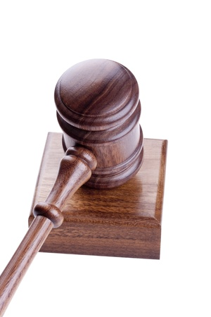 arbitrate: Wooden hammer used in court and in auctions. Stock Photo