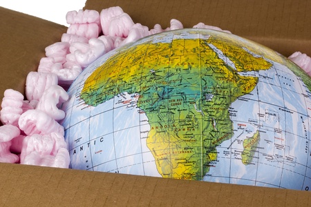 Close-up of a globe in a delivery box.