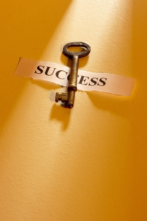 key to success: A key laying on a piece of paper with the word