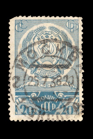 USSR - CIRCA 1969: A postal stamp printed in the USSR which shows Coat of arms of Russian Soviet Federative Socialist Republic since Soviet times, circa 1969.