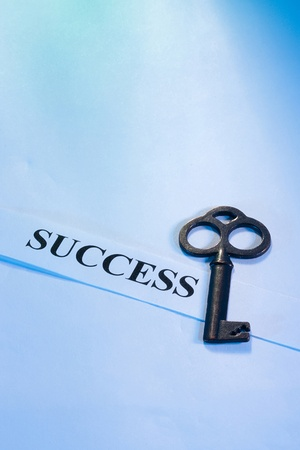 A key laying on a piece of paper with the word Stock Photo - 10739676