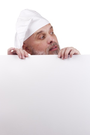 Portrait of a chef holding a blank sign for your text. Stock Photo - 10837496