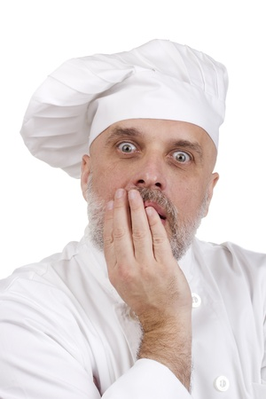 Portrait of a scared chef on white. Stock Photo - 11108548