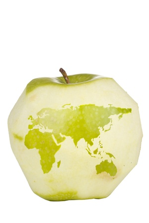Green apple with a carving of the world map isolated on a white background. Stock Photo