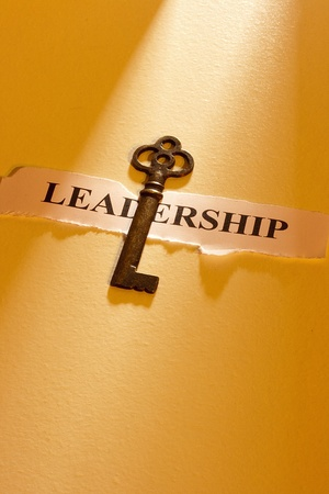 leadership qualities: A key laying on a piece of paper with the word