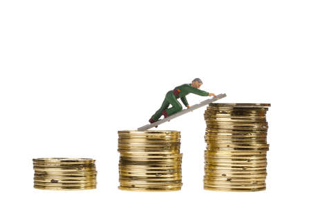 Toy man climbing his career ladder of golden coins isolated on a white background. Stock Photo - 12538809