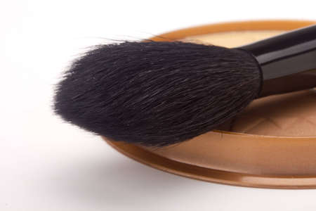 black powder: Black powder brush and brown powder isolated on a white background.