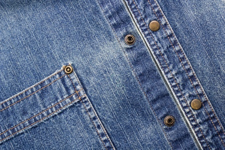 Close-up photograph of deep blue denim material. photo